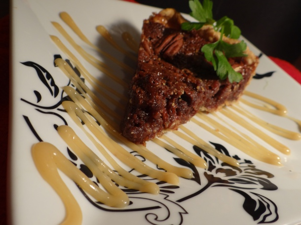 Chocolate Bourbon Pecan Pie with a White Chocolate Drizzle