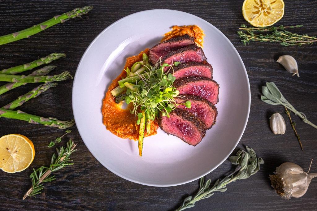 Seared Bison NY Strip with sweet potato mash & sautéed asparagus